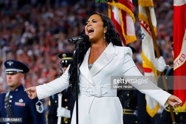 Demi Lovato performs the national anthem before the San Francisco 49ers face off against the Kansas City Chiefs before Super Bowl LIV at Hard Rock...