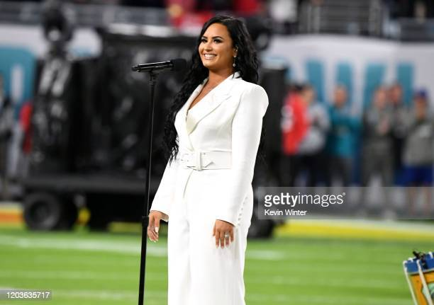 Demi Lovato performs the National Anthem onstage during Super Bowl LIV at Hard Rock Stadium on February 02 2020 in Miami Gardens Florida