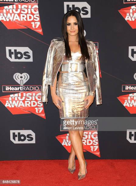 Demi Lovato poses in the press room at the 2017 iHeartRadio Music Awards at The Forum on March 5 2017 in Inglewood California