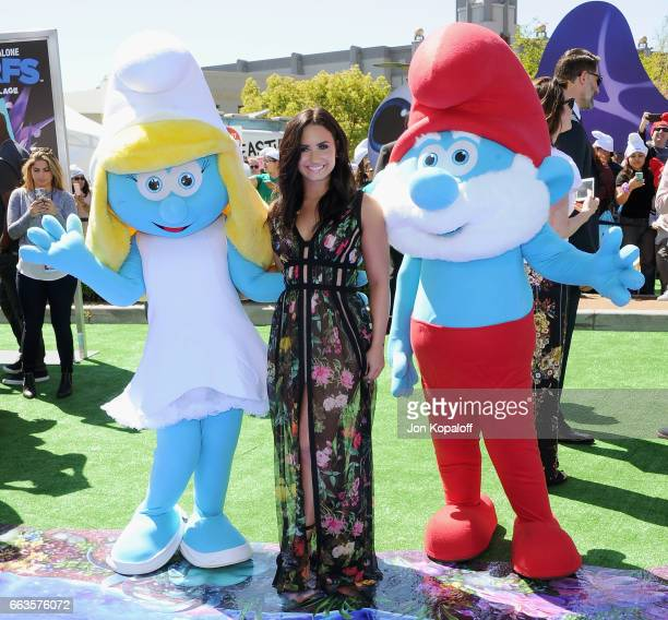 Demi Lovato posing with Smurf at the Los Angeles Premiere 'Smurfs The Lost Village' at ArcLight Cinemas on April 1 2017 in Culver City California