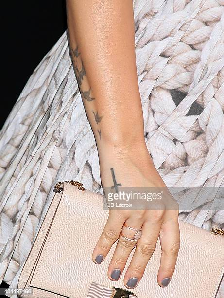 Demi Lovato tattoo detail attends the Samsung launch party on August 18 2015 in West Hollywood California