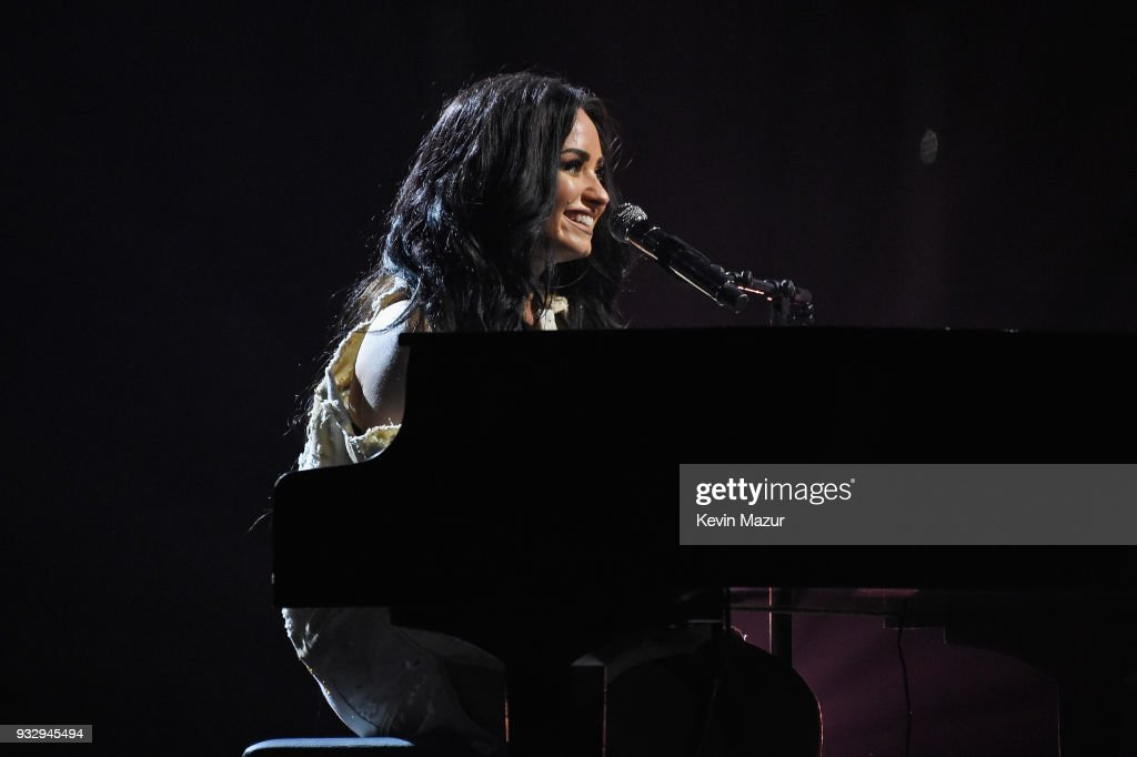 Demi Lovato tears up onstage as she performs during the 'Tell Me You Love Me' World Tour at Barclays Center of Brooklyn on March 16, 2018 in New York City.