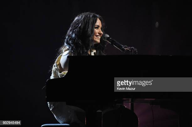 Demi Lovato tears up onstage as she performs during the 'Tell Me You Love Me' World Tour at Barclays Center of Brooklyn on March 16 2018 in New York...