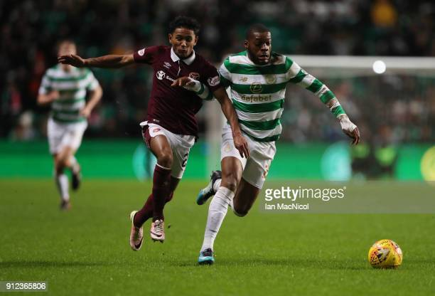 Demi Mitchell of Heart of Midlothian vies with Olivier Ntcham of Celtic during the Scottish Premier League match between Celtic and Heart of...