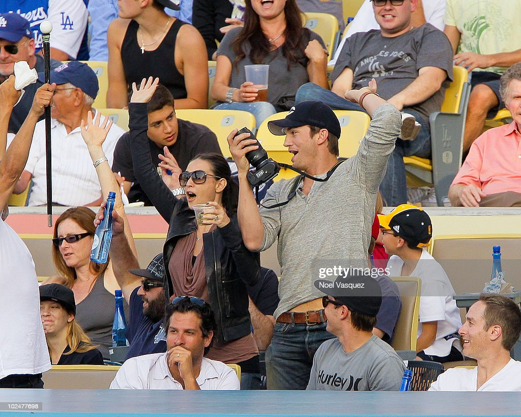 Demi Moore (L) and Ashton Kutcher attend a game between the New York Yankees and the Los Angeles Dodgers at Dodger Stadium on June on June 27, 2010 in Los Angeles, California.