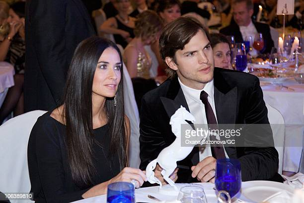 Demi Moore and Ashton Kutcher attend the Demi & Ashton Foundation and the Russian Assemblies Charity Gala in the Ritz-Carlton hotel on October 30,...