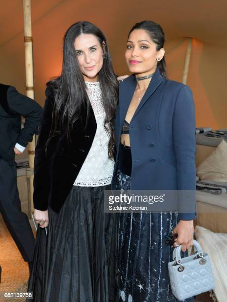 Demi Moore and Freida Pinto at Christian Dior Cruise 2018 Show and After Party at Gladstone's Malibu on May 11 2017 in Malibu California