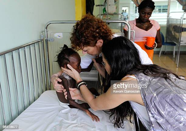 Demi Moore and Susan Sarandon visit the pedeatric ward of St Damien�s children's hospital on April 12 2010 in PortauPrince Haiti Moore is cofounder...