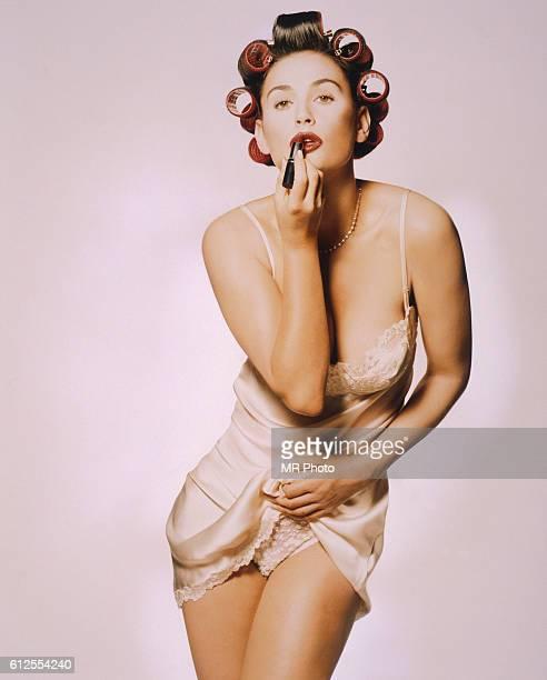 Demi Moore Applying Lipstick