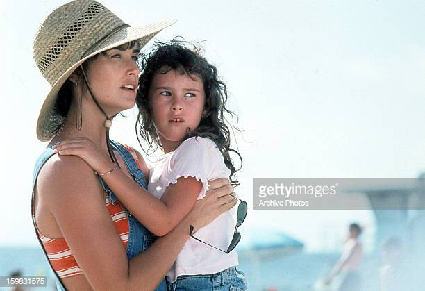 Demi Moore holds her daughter, Rumer Willis in a scene from the film 'Striptease', 1996.