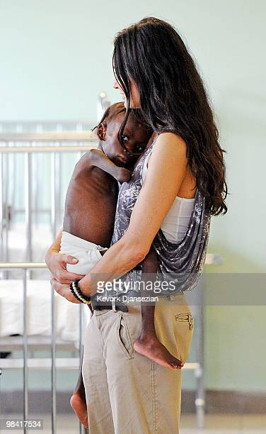 Demi Moore holds Shakyna who is suffering from malnutrition as she visit the pedeatric malnutrition ward of St Damien�s children's hospital on April...