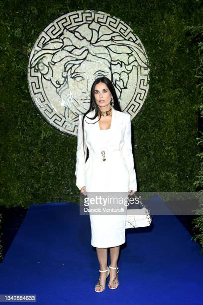 Demi Moore is seen on the front row of the Versace special event during the Milan Fashion Week - Spring / Summer 2022 on September 26, 2021 in Milan,...