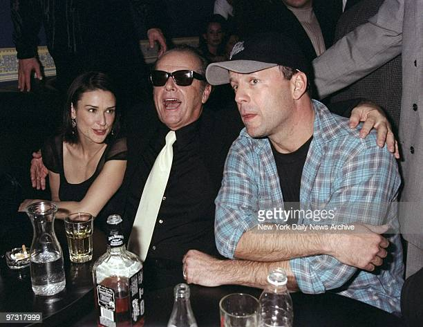 Demi Moore Jack Nicholson and Bruce Willis share a table at the China Club where Bruce Willis and The Accelerators band were holding a benefit...
