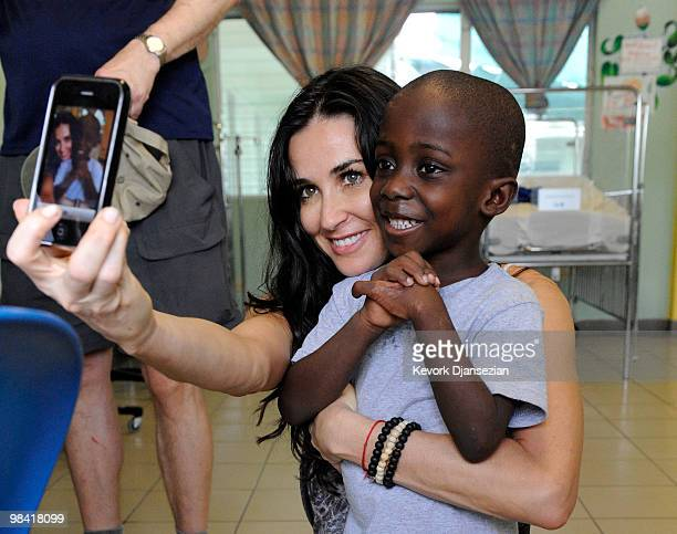Demi Moore takes her picture with Davidosn during the visit to the pedeatric malnutrition ward of St Damien�s children's hospital on April 12 2010 in...