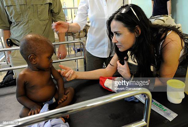 Demi Moore visits the pedeatric ward of St Damien�s children's hospital on April 12 2010 in PortauPrince Haiti Moore is cofounder of the Demi and...