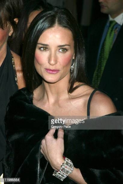 Demi Moore wearing a dress and fur wrap by Donna Karan and Fred Leighton jewelry