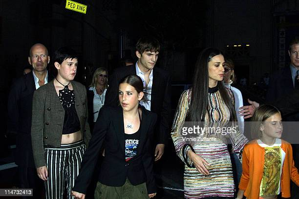 Demi Moore with boyfriend Ashton Kutcher exhusband Bruce Willis and their daughters arriving for the premiere of 'Charlie's Angeles at Mannn's...