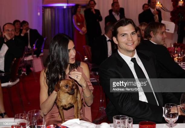 Demi Moore with gary Kessler's dog Herr Brodmann and Ashton Kutcher attend the PlusCity Charity Gala at PlusCity on October 29 2010 in Pasching near...