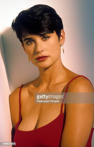 Demi Moore with short hair and wearing a spaghetti strap top, circa 1990.