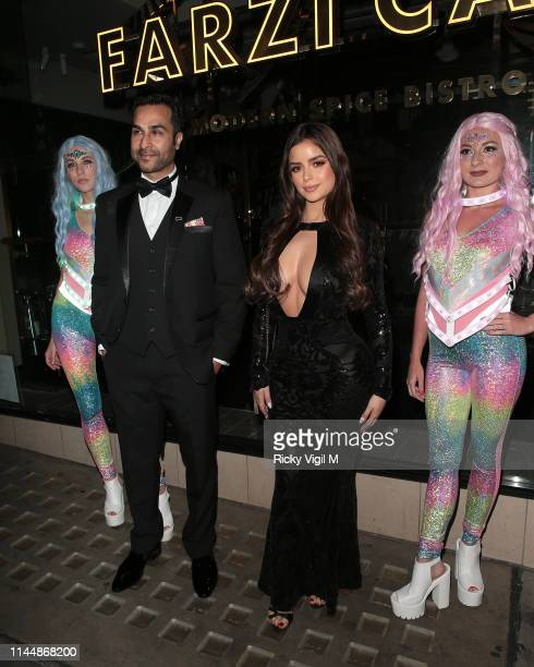 Demi Rose seen with Shaz Memon founder of Digimax Dental attending 'For The Chosen Few' event at Farzi Cafe on April 24 2019 in London England