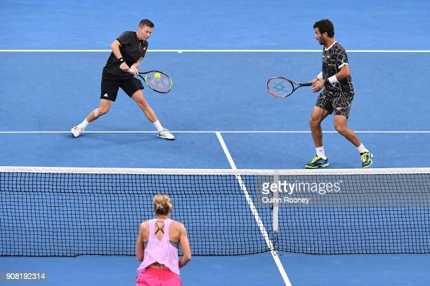 Demi Schuurs of the Netherlands and JeanJulien Rojer of the Netherlands in their first round mixed doubles match against Monique Adamczak of...