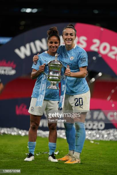Demi Stokes and Lucy Bronze of Manchester City celebrate with the Vitality Women's FA Cup Trophy following their team's victory in the Vitality...