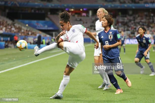Demi Stokes of England clears the ball during the 2019 FIFA Women's World Cup France group D match between Japan and England at Stade de Nice on June...