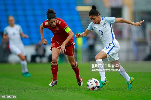 Demi Stokes of England competes for the ball with Marta Torrejon of Spain during the International Friendly match between Spain and England Women...