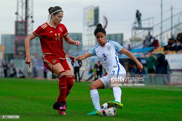Demi Stokes of England competes for the ball with Vicky Losada of Spain during the International Friendly match between Spain and England Women...
