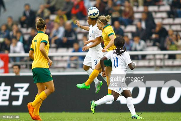 Demi Stokes of England heads the ball in the match between England and Australia during the 2015 Yongchuan Women's Football International Matches at...