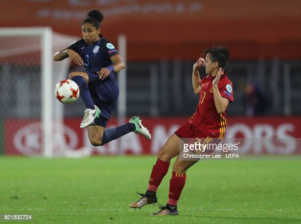 Demi Stokes of England wins the ball in the air from Marta Corredera of Spain during the UEFA Women's Euro 2017 Group D match between England and...