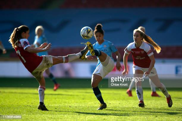 Demi Stokes of Manchester City and Danielle Van De Donk and Beth Mead of Arsenal in action during the Continental League Cup Final between Arsenal...