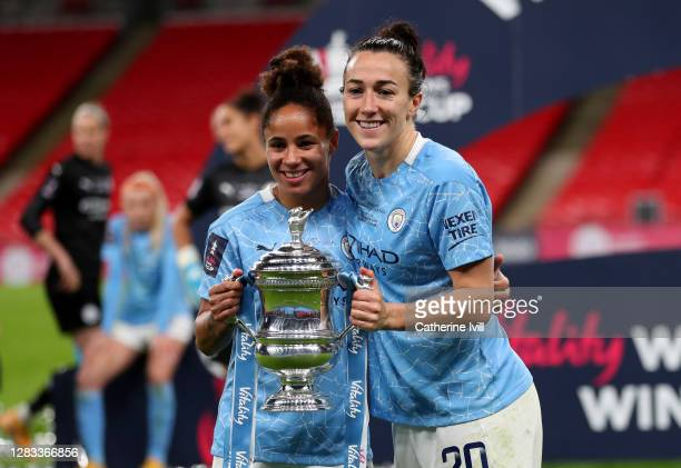 Demi Stokes of Manchester City and Lucy Bronze of Manchester City celebrate with the Vitality Women's FA Cup Trophy following their team's victory in...