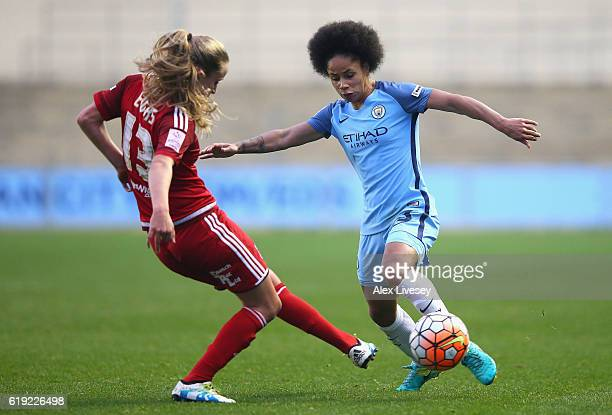 Demi Stokes of Manchester City attemts to take the ball past Marisa Ewers of Birmingham City during Women's Super League1 match between Manchester...