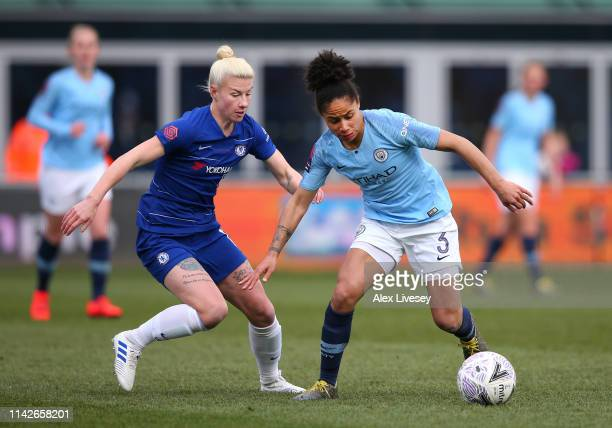 Demi Stokes of Manchester City Women beats Bethany England of Chelsea Women during the Women's FA Cup Semi Final match between Manchester City Women...