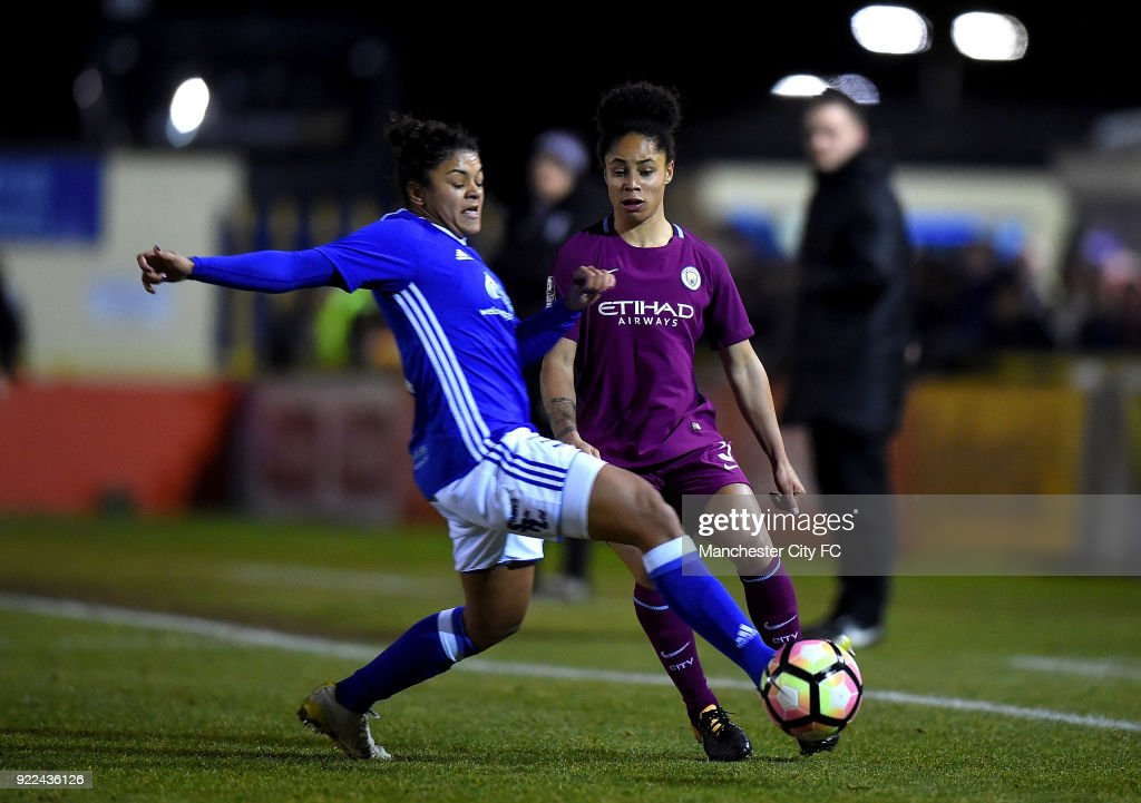 Demi Stokes of Manchester City Women is tackled by Jess Carter of Birmingham City Ladies during the WSL match between Birmingham City Ladies and Manchester City Women at Damson Park on February 21, 2018 in Solihull, England.
