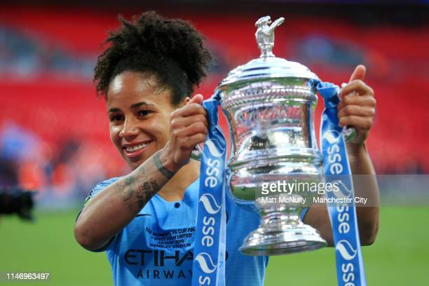 Demi Stokes of Manchester City Women poses with the Women's FA Cup Trophy following her team's victory in the Women's FA Cup Final match between...