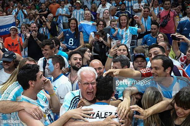 Demian Gonzalez of Argentina celebrates with fans after winning the men's qualifying volleyball match between Russia and Argentina on Day 4 of the...