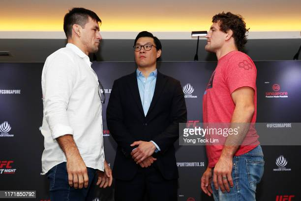 Demian Maia and Ben Askren face off in front of UFC Asia Pacific senior vice president Kevin Chang after a UFC Singapore onsale press conference at...