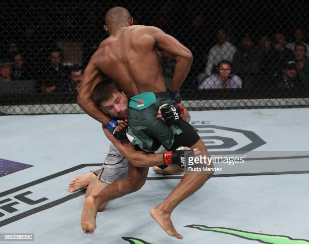 Demian Maia of Brazil attempts to take down Kamaru Usman of Nigeria in their welterweight bout during the UFC Fight Night event at Movistar Arena on...