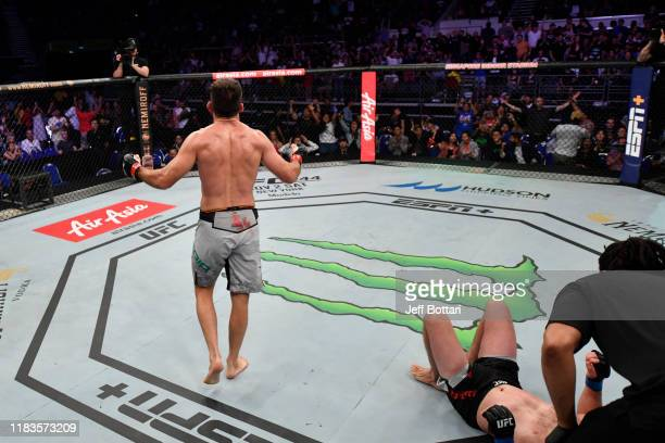 Demian Maia of Brazil celebrates his submission victory over Ben Askren in their welterweight bout during the UFC Fight Night event at Singapore...