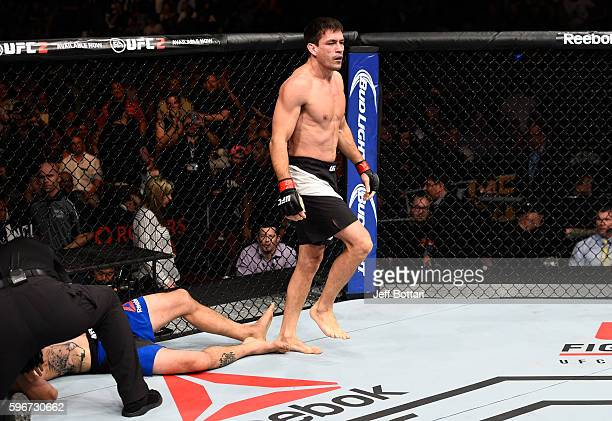 Demian Maia of Brazil celebrates his submission victory over Carlos Condit of the United States in their welterweight bout during the UFC Fight Night...