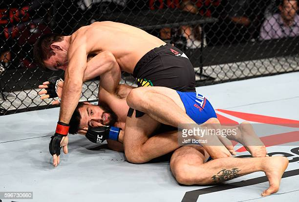 Demian Maia of Brazil controls the body of Carlos Condit of the United States in their welterweight bout during the UFC Fight Night event at Rogers...