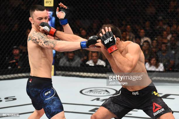 Demian Maia of Brazil punches Colby Covington in their welterweight bout during the UFC Fight Night event inside the Ibirapuera Gymnasium on October...
