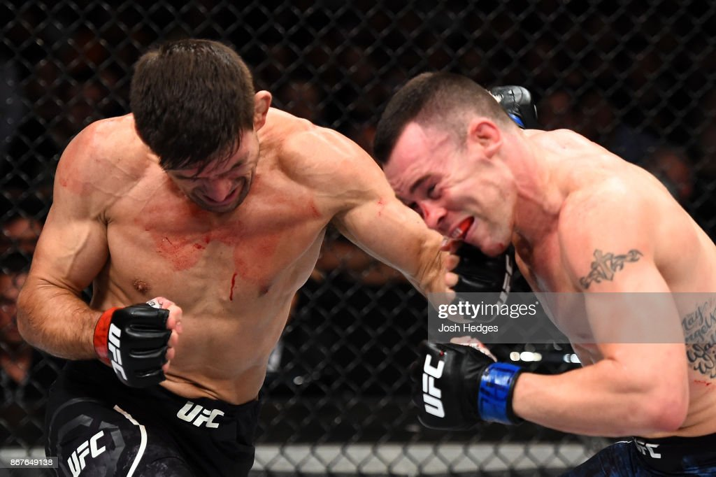 Demian Maia of Brazil punches Colby Covington in their welterweight bout during the UFC Fight Night event inside the Ibirapuera Gymnasium on October 28, 2017 in Sao Paulo, Brazil.