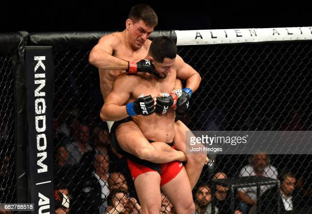 Demian Maia punches Jorge Masvidal in their welterweight fight during the UFC 211 event at the American Airlines Center on May 13 2017 in Dallas Texas