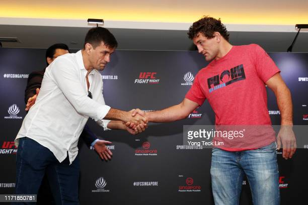 Demian Maia shakes hands with Ben Askren after a UFC Singapore onsale press conference at the Mandarin Oriental Hotel on September 03 2019 in...