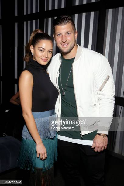 DemiLeigh NelPeters and Tim Tebow attend DIRECTV Super Saturday Night 2019 at Atlantic Station on February 2 2019 in Atlanta Georgia