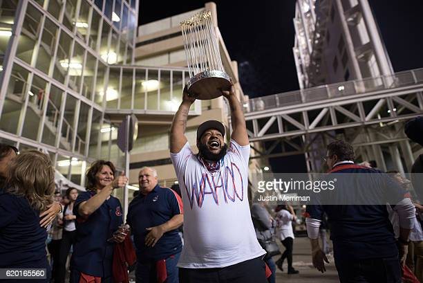 Demilles Jones of Cleveland holds a homemade World Series trophy outside of Progressive Field during game 6 of the World Series against the Chicago...