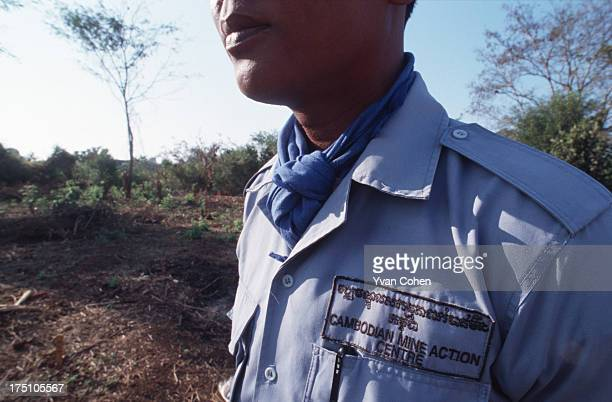 De-miner from the Cambodian Mine Action Center stands by in a heavily mined area. Millions of anti-personnel mines still litter the Cambodian...
